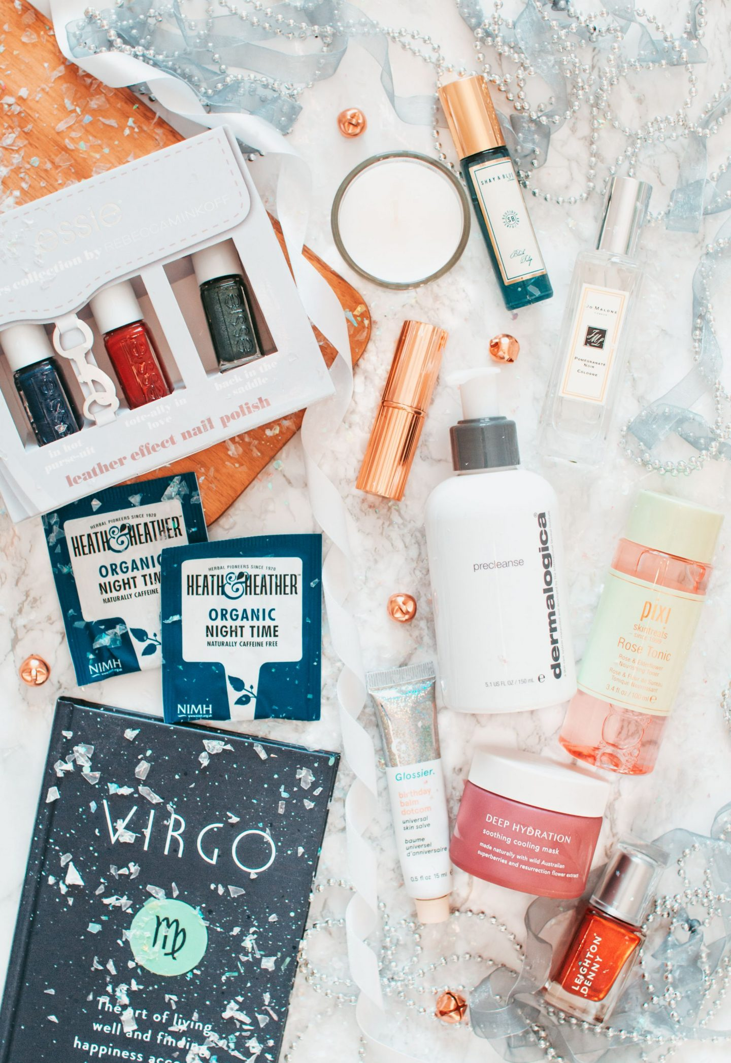 the ultimate gift guide for her, forever september, flatlay, lifestyle, beauty, christmas, gift guide, skincare, beauty, fragrance, charlotte tilbury, dermalogica, pixi, jo malone, shay and blue, essie, tea, virgo, books, tropic, lipstick, candle, anthropologie, diptique